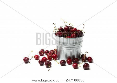 Little Brass Bucket Of Cherries Isolated On White Background