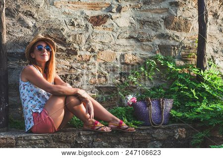 Young Woman Enjoying Sunset At S Balcony