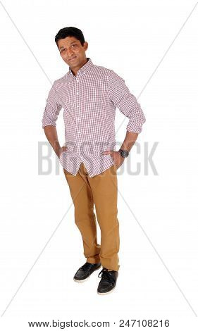 A Handsome Middle Age Man Standing In A Red Checkered Shirt With His Hands In Pocket, Looking At Cam
