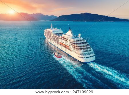 Cruise Ship At Harbor. Aerial View Of Beautiful Large White Ship At Sunset. Colorful Landscape With