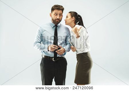 Secret, Gossip Concept. Young Woman Whispering A Secret Behind Her Hand To Boss. Business Woman Isol