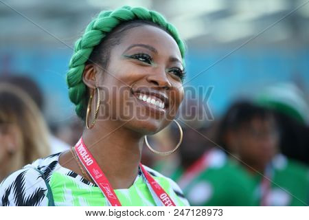 ST. PETERSBURG, RUSSIA - JUNE 26, 2018: Nigerian football fan with green braid at Saint Petersburg stadium before the match of FIFA World Cup 2018 Nigeria vs Argentina. Argentina won 2-1