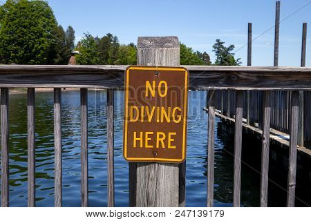 A No Diving Warning Sign On The Docks At Lake George In New York