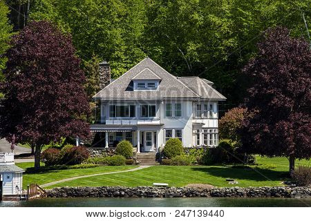 A Mansion By The Water In Lake George New York