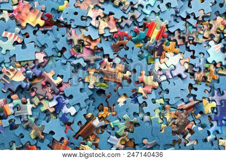 MONTREAL-CANADA, JUNE 23, 2018:  Jigsaw puzzles were originally created by painting a picture rectangular piece of wood, and then cutting that picture into small pieces with a jigsaw, hence the name.