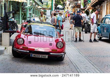 Saalbach-hinterglemm, Austria - June 21 2018: Ferrari Dino Oldsmobile Vintage Veteran Cars Preparing