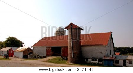 Barn With A Parked Amish Buggy