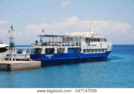 TILOS, GREECE - JUNE 17, 2018: Ferry boat Panagia Spiliani moored at Livadia harbour on the Greek island of Tilos. The 42.65mtr passenger vessel was built in 1998.