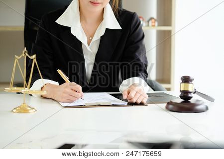 Close Up Judge Gavel Justice Lawyers, Business Woman In Suit Or Lawyer Working On A Documents. Legal