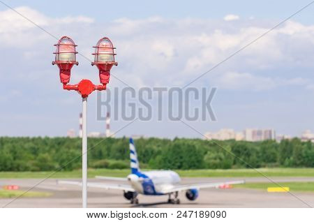 Red Warning Warning Light With The Light On, Against The Blue Sky. Close Up Aircraft Warning Light O