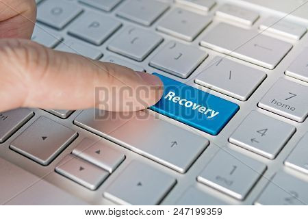 Recovery Word On Red Keyboard Button. Inscriptions On The Grey Silver Keyboard Button Close Up