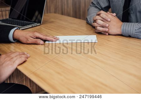 Hand of employer filing final remuneration to employee, letter of resignation, resign concept. poster