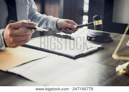 Judge Gavel With Justice Lawyers, Businessman In Suit Or Lawyer Working On A Documents In Courtroom.