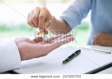Husband And Wife Are Signing Decree Of Divorce (dissolution Or Cancellation) Of Marriage Filing Divo