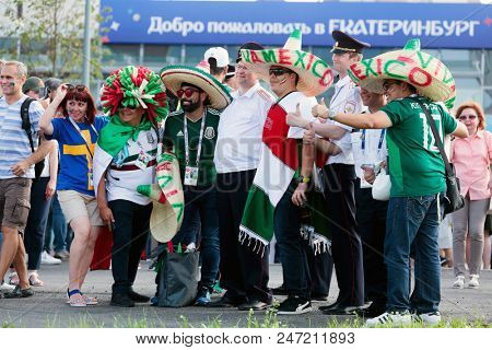 YEKATERINBURG, RUSSIA - June 27, 2018: FIFA World Cup 2018, Mexican and sweden football fans on the streets of Yekaterinburg