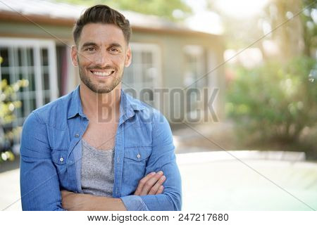 Portrait of 40-year-old man relaxing outside