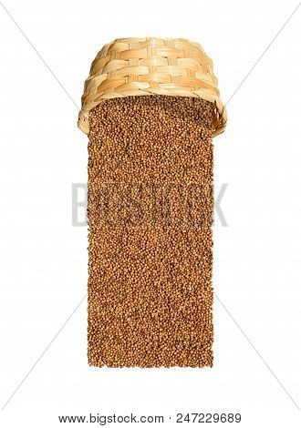 Coriander Seeds (coriandrum Sativum) Poured Out Of Wicker Basket Isolated On White Background With C