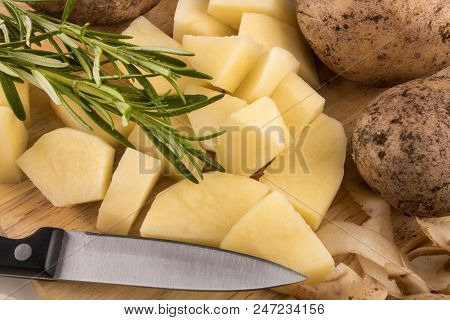 Into Very Small Cube Cut Organic Potatoes With Rosemary