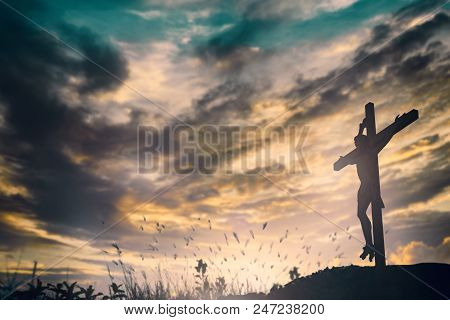 Silhouette Of Jesus With Cross Over Sunset Concept For Religion, Worship, Christmas, Easter, Redeeme