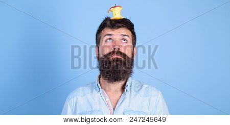 Live Target Concept. Man Handsome Hipster Long Beard Almost Eaten Apple Stump On Head As Target. Wei