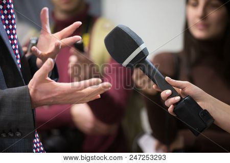 The Correspondent Interviews.microphone And Hands. Interviewer And Respondent. The Reporter Is Inter