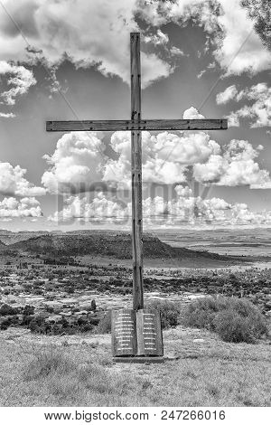 Ficksburg, South Africa - March 12, 2018:  A Wooden Cross With The Ten Commandments Engraved On A Gr