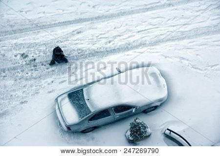 elevated view of parked car covered with snow