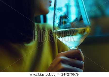 Young Woman Drinking Wine. White Wine Glass. Close Up Of Woman Drinking Wine. Glass Of White Wine. W