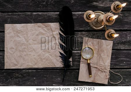 Blank Crumpled Paper Page Letter, Loupe Magnifier, Feather Ink Pen And Wrapped In Jute Rope Envelope