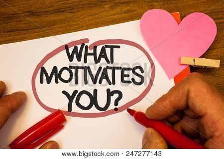 Handwriting Text What Motivates You Question. Concept Meaning Passion Drive Incentive Dream Aspirati