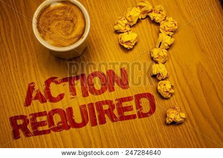 Text sign showing Action Required. Conceptual photo Important Act Needed Immediate Quick Important Task Words written Desk Coffee White mug crumbled paper notes question mark poster