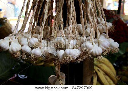 Braided Garlic Hanging In A Guatemalan Market