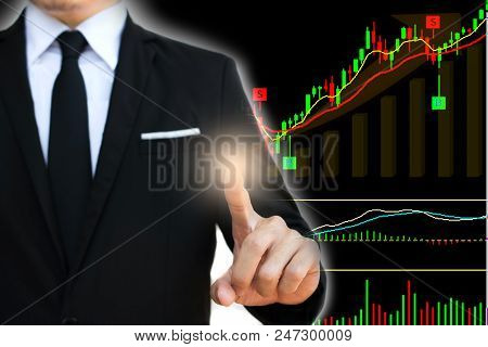 Businessman Touch On Vitual Screen With Stock Charts Showing Growing Revenue