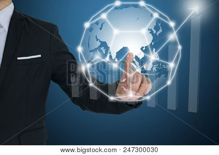 Businessman Touching Global  Network And Financial Charts Showing Growing Revenue. Communication And