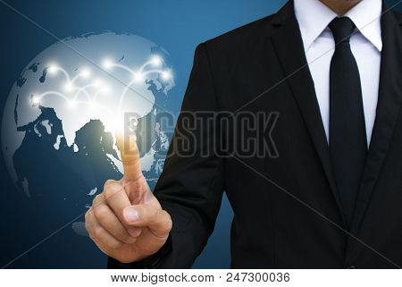 Businessman Touching Global  Network. Communication And Social Media Concepts.