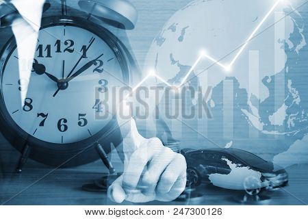 Businessman Touch On Vitual Screen On Blue Background.
