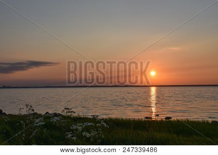 Sunset By The Oland Bridge In Sweden. The Bridge Is Connecting The Island Oland With Mainland Sweden