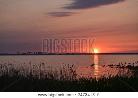 Beautiful Sunset By The Olandbridge In Sweden, The Bridge Is Connecting The Island Oland With Mainla