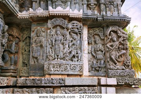 Ornate Wall Panel Reliefs Depicting From Left Harihara, Arjuna Shooting Arrow At The Fish, A Drumer,
