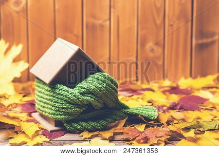 Protecting And Isolating House. Scarf Around House Model On Wooden Table. Small Miniature Of House I