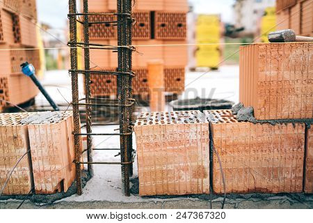 Details Of House Building, Brick Walls And Steel Infrastruture. Construction Site