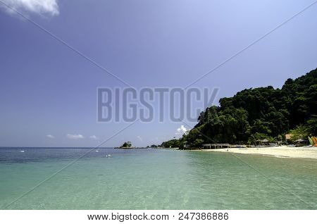 Scenic Sea View Of The Kapas Island At Terengganu, Malaysia. Clear Sea Water And Blue Sky Background