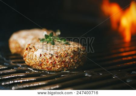 lamb burgers spiced by mint and lamb rub on bbq grill with flame