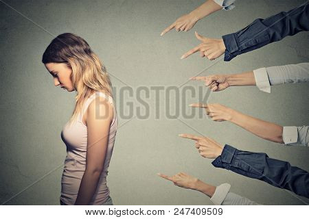 Concept Of Accusation Guilty Person Girl. Side Profile Sad Upset Woman Looking Down Many Fingers Poi