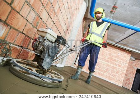 Concrete flooring. using walk-behind power trowel machine for surface floating