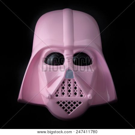JUNE 28 2018: Concept of a female feminine Pink Darth Vader mask on dark background, halloween costume for girls