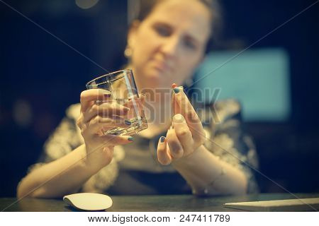 Close-up Of Office Worker Sick Woman Holding Pill Glass Of Water. Depressed Unhealthy Woman, About T