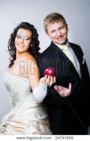 Just Married Bride Tempting Smiling Groom By Red Apple