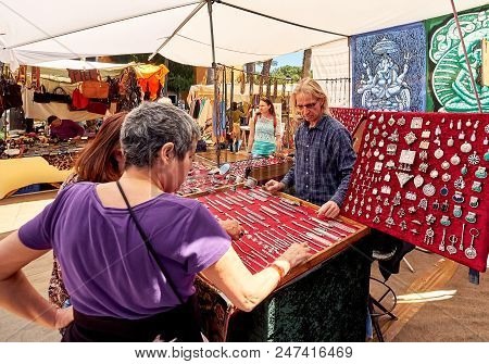 Ibiza Island, Spain - May 2, 2018: Seller And Buyers At The Hippy Market Of Ibiza Island. Stall Sell
