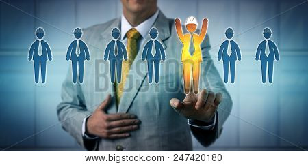 Unrecognizable Recruiter Selecting One Cheering Male Blue Collar Worker Among Seven Candidates. Recr